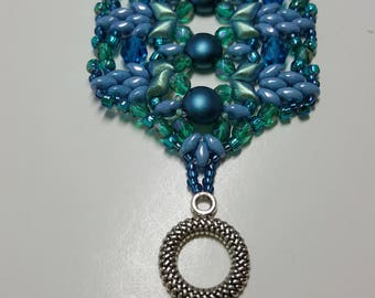Wide beaded  bracelet in shades of blue and aqua