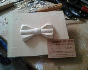 Wooden bow-tie made entirely by hand.