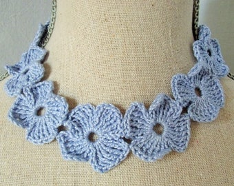 Sky blue cotton collar with crochet flowers.