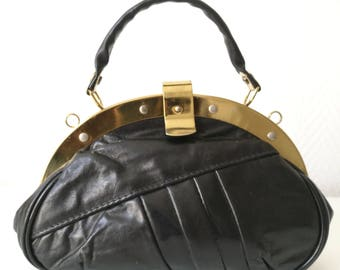 Vintage purse in faux black leather and metal