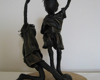 Little Footballers.  Sculpture of boys playing football. Sculpture of footballer. Made to order