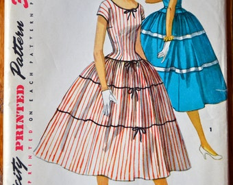 """1950's Simplicity One Piece Dress with full, tiered skirt pattern - Bust 34"""" - UNCUT - no. 1083"""