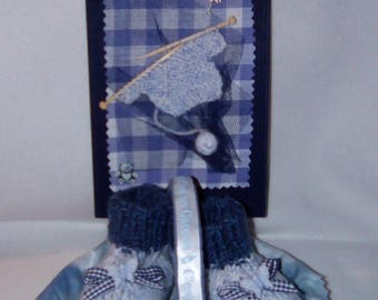 knitted baby shoes hand in hand painted and decorated basket