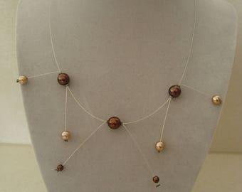 Fine and original necklace in brown tones