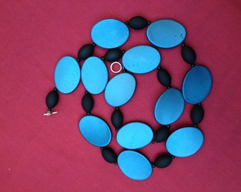 Tilted: Handmade Necklace Featuring Teal Acrylic Beads