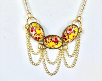 Three Floral Ovals with Dangle Chains
