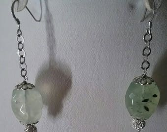 Earrings in silver with quartz and swaroschi