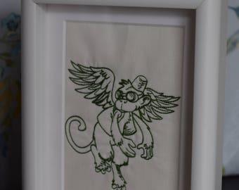 Framed embroidered Winged Monkey, flying monkey.