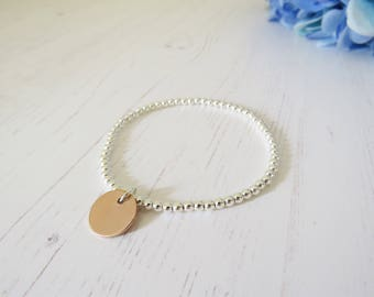 A sterling silver beaded bracelet with a rose gold filled disc that can be handstamped with your personalisation