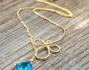 With wire plate flower lariat necklace gold and Sapphire Crystal glass