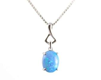 Blue opal pendant etsy sky blue opal pendant small sterling silver pendant blue opal jewellery silver jewelry mozeypictures Gallery