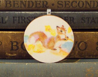 Round Wooden Squirrel Pendant - Squirrel with a Nut - Vintage Book Illustration - Wood Squirrel Charm - Paper Ephemera Book Charm