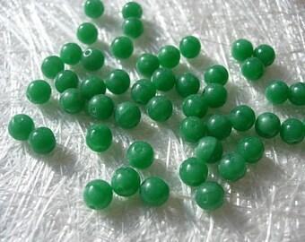 set of 50 Czech glass round beads, 6 mm emerald green