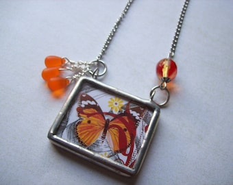 Orange butterfly pendant necklace.Orange glass drops.Double sided pendant.