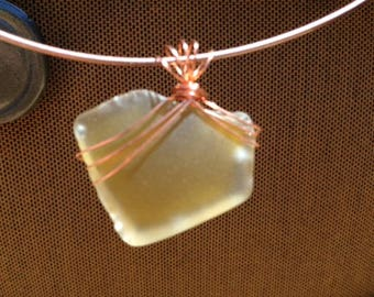 yellow seaglass wrapped in gold tarnish resistant wire
