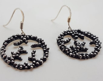 Dangling earrings in 925 Silver oxidized (blackened) with granulation (silver beads) of different size on pattern