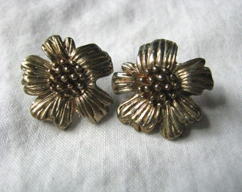 Vintage gold tone flower post back earrings with textured center