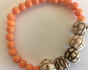 Orange and simulated bone Bead Bracelet