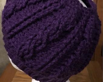 Purple cable stitch messy bun hat