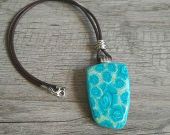 Mini pendant with turquoise roses and irregular shape-flower pendant-unique jewelry in polymer clay-pendant millefiori blue roses.