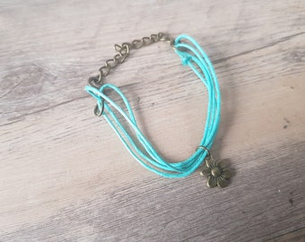 1 turquoise cord with a charm bracelet flower - brass