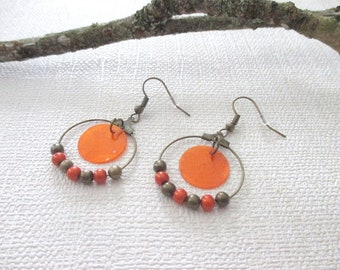 Orange single feather earring with sequin and bronze hoop earrings