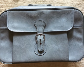 Pale blue suitcase