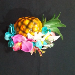The Ashley! Pineapple fascinator with gorgeous orchids, lilies and blue flowers . Great for Viva pool party or Tiki Oasis!