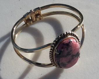 Oval Rhodonite Cabochon In Gold Tone Bracelet