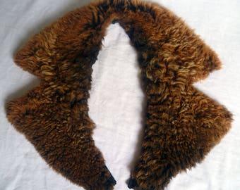 Back to fasten with buttonholes lamb fur collar. man woman. garment