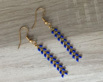 Earrings dangling gold chain and spikes