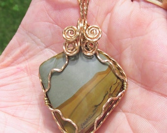 Scenic Jasper cabachon Pendant, wire wrapped in twised Bronze wire