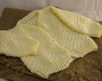 Handmade Crocheted baby sweater in yellow.