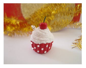 1 small CUPCAKE cherry whipped cream decorated with a small cherry