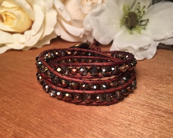 Brown leather triple wrap bracelet with emerald and copper glass beads