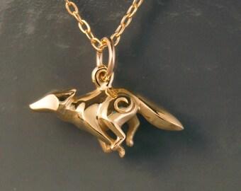 bronze running coyote