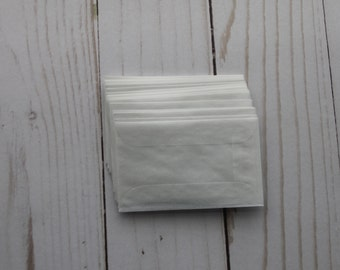 """25 Small Glassine Envelopes with flap on long side 1 3/4"""" x 2 7/8"""""""