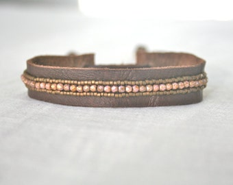 Faceted pink with  gold sheen czech glass and leather strap bracelet