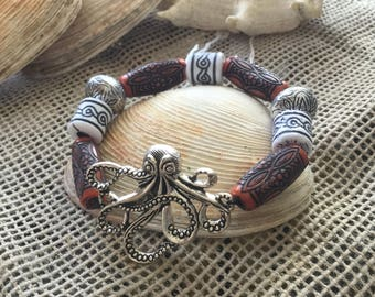 Silver plated octopus stretch bracelet with orange & white etched beads