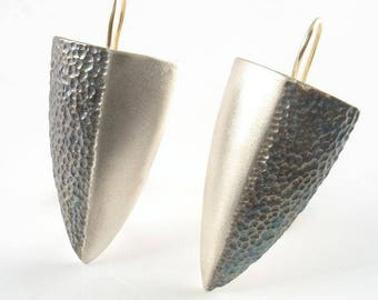 Sterling silver half shield on solid gold wire.Half hammered and oxidized ,second half matte finish.Elegant, classic, chic,glamour earrings.