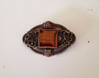 Wonderful old brooch with gold glass stone and great detail