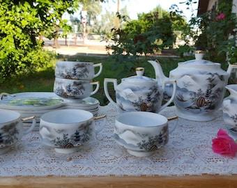 Vintage Hakusan China tea set with snack plates, made in Japan.  Pagoda scene.