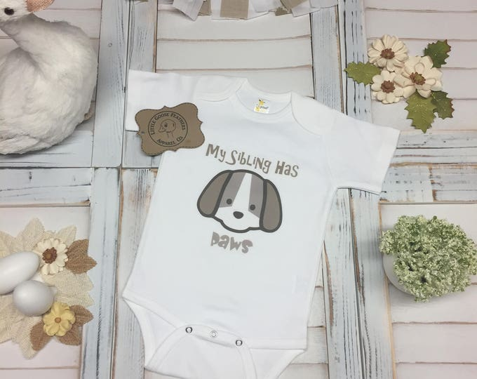 Featured listing image: My Sibling Has Paws Text with Cartoon Puppy Drawing Animal Design. Available as a Bodysuit (Onesie), Toddler T-Shirt or Girls Fringe Dress.