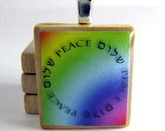 Circle of Peace - Shalom - Hebrew Scrabble tile pendant on rainbow background