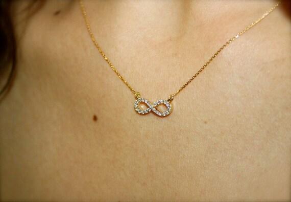 Infinity diamond necklace 18k gold and VSG diamonds infinity