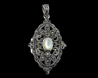 Marcasite pendant etsy marcasite and mother of pearl oval fancy filigree locket pendant decorative fancy art deco style locket nacre sterling silver 925 silver aloadofball Images