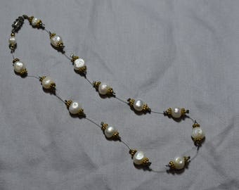 Freshwater pearls and gold illusion