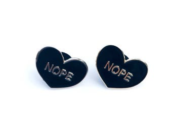 NOPE // anti-valentine enamel pin // black heart shaped lapel pin // from Mod Evil