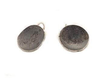 Black Moon big earrings.