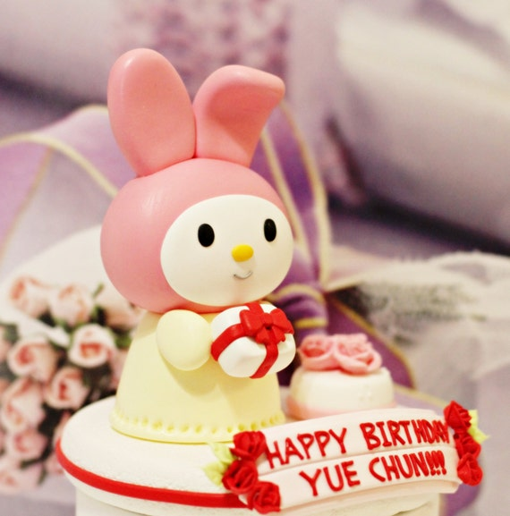 A cute Rabbit Birthday Cake Topper